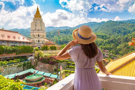 Woman traveler at  Kek Lok Si Temple in Georgetown, Penang island, Malaysia