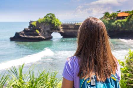 Woman traveler at  Pura Batu Bolong Temple on Bali, Indonesia in a sunny day Standard-Bild