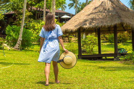 Woman traveler at  Gazebo at Luxury tropical resort  in a sunny day