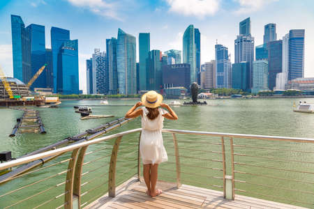 Woman traveler  looking at Beautiful Singapore cityscape in a sunny day