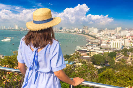 Woman traveler at  Panoramic aerial view of Pattaya Gulf, Thailand in a summer day Standard-Bild