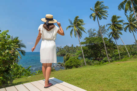 Woman traveler at Luxury tropical resort  in a sunny day