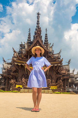 Woman traveler at  Sanctuary of Truth in Pattaya in a summer day