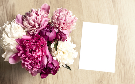 Mockup With A Beautiful Peony Bouquet And A Vertical Card Reklamní fotografie
