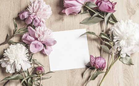Mockup With Peony Flowers And A Square Card Archivio Fotografico