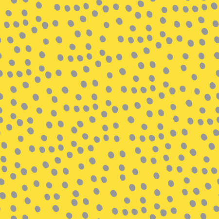 Seamless repeating spotted pattern with tiny hand drawn dots. Yellow vector background for surface design and other design projects