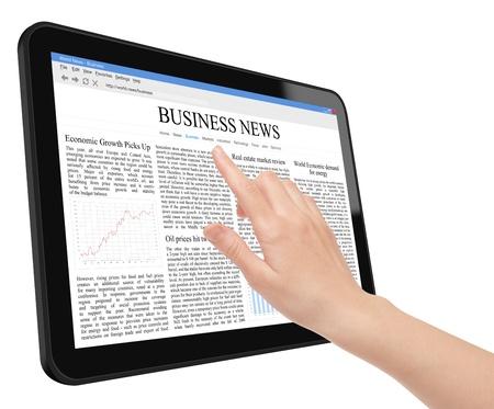 �cran tactile: Main touch screen sur tablet pc avec business news  Banque d'images