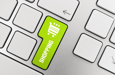 Shopping button on modern aluminium keyboard. You may easily change icon color in Adobe Photoshop using HueSaturation filter (Ctrl+U on PC or Cmd+U on Mac shortcut). photo