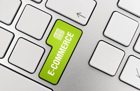 Electronic commerce button on modern aluminium keyboard.