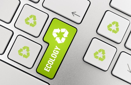 Button with recycle symbol on modern aluminium keyboard. Stock Photo - 9830727