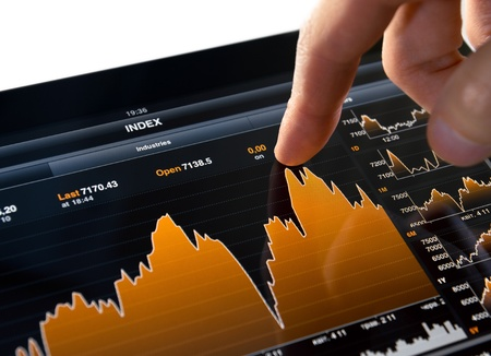 stock graph: Touching stock market graph on a touch screen device. Stock Photo