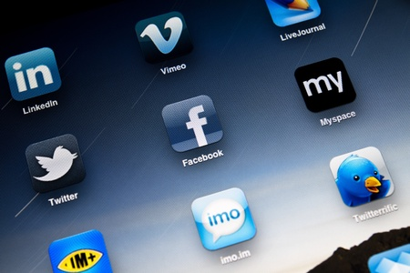 Kiev, Ukraine - July 04, 2011: Close up photo of Apple iPad 2 screen showing most visited social media apps, including Facebook, Myspace, Twitter, LinkedIn, Vimeo, LiveJournal and Twitter.