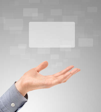 proposing: Business hand propose floating touch screens on a light gray background Stock Photo