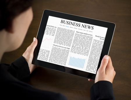 business news: Business woman reading business news on the touch screen device. Stock Photo