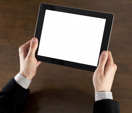 Businessman hands are holding the touch screen device. photo
