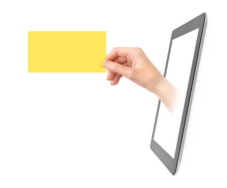 Female hand showing yellow translucent business card from blank digital tablet pc. Isolated on white. photo