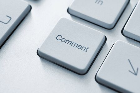 commentary: Comment button on the keyboard. Toned Image.