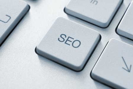 interaccion social: SEO bot�n en el teclado. Imagen virada. Foto de archivo