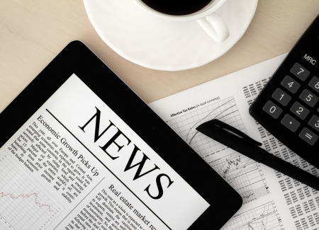 Desktop with a Tablet PC, which shows the latest news on screen. Stock Photo - 10962182