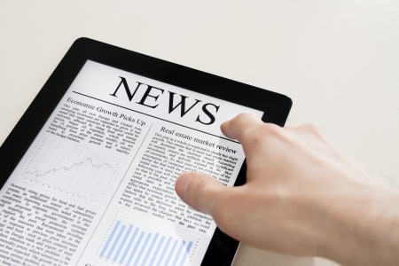 Man hands are touching tablet pc with business news. Stock Photo - 11049091