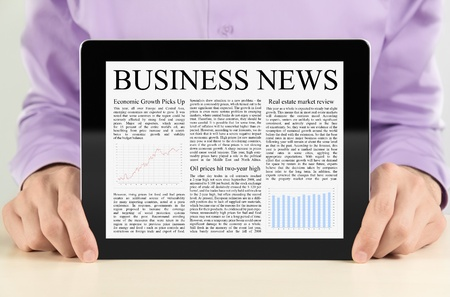 Businessman showing digital tablet pc with business news on screen. Stock Photo - 11388008