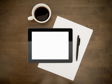 office desktop: Blank digital tablet with paper, pen and cup of coffee on worktable. Stock Photo