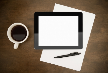 Blank digital tablet with paper, pen and cup of coffee on worktable. Stock Photo