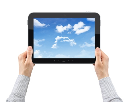 Businessman hands are holding the digital tablet with cloudy sky on the screen. Isolated on white. photo