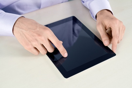 Businessman hands are touching on contemporary tablet pc. photo