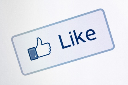 admiration: Kiev, Ukraine - December 8, 2011: Closeup shot of Facebook like button on a monitor screen. One of the most popular forms of internet communication between users at this time.