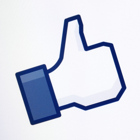 Kiev, Ukraine - December 8, 2011: Closeup shot of Facebook thumbs up symbol on a monitor screen. One of the most popular forms of internet communication between users at this time.
