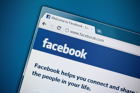 Kiev, Ukraine - December 8, 2011: Photo of Facebook homepage on a monitor screen. Facebook is a most visited social media website in the world.
