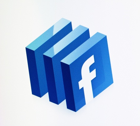 Kiev, Ukraine - December 15, 2011: Close-up view of Facebook sign on a monitor screen. Facebook is a most visited social media website in the world.