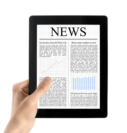 Man hands are holding electronic tablet with news. Isolated on white. photo