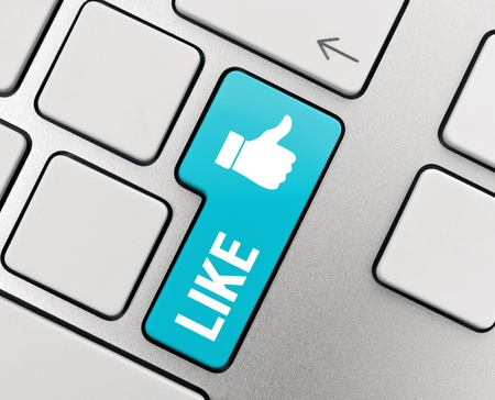Like it with thumb up symbol on modern aluminium keyboard. Stock Photo - 11840015