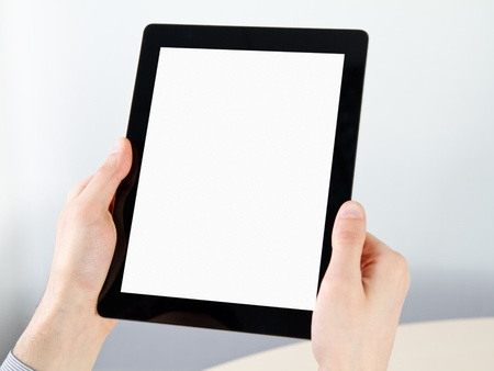 Man hands holding electronic tablet pc with blank screen. photo
