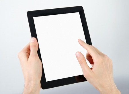 Man hands holding and point on electronic tablet pc with blank screen. photo