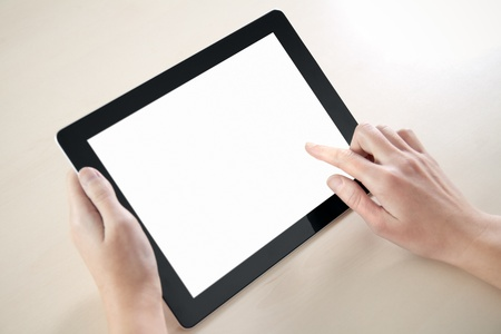 Woman hands holding and point on electronic tablet pc with blank screen.