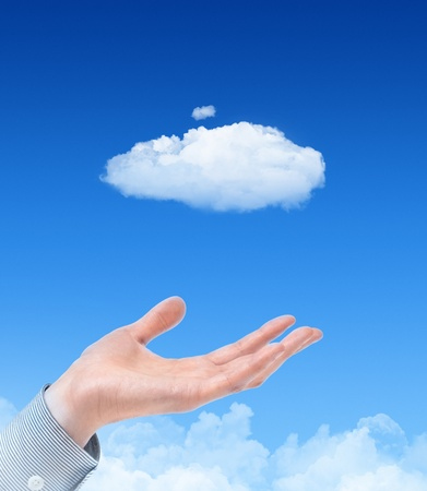 Man hand propose cloud against blue sky with clouds on background. Concept image on cloud computing and eco theme. Stock Photo - 11978140