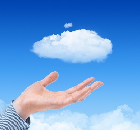 offerings: Man hand propose cloud against blue sky with clouds on background. Concept image on cloud computing and eco theme.