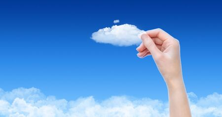 cloud network: Woman hand hold the cloud against blue sky with clouds. Concept image on cloud computing and eco theme with copy space. Stock Photo
