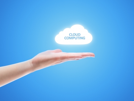 Woman hand share the cloud against blue background. Concept image on cloud computing theme with copy space. Stock Photo