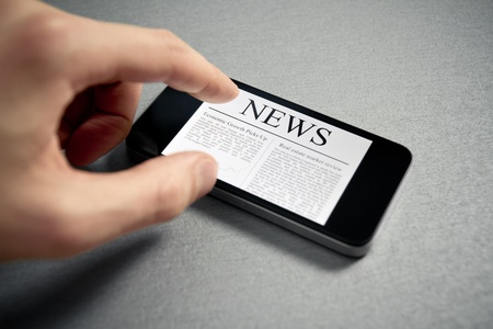 Man hand touch screen with news on contemporary mobile phone. Added a slight vignetting for dramatic effect and focus on the main headline. Stock Photo - 12181414