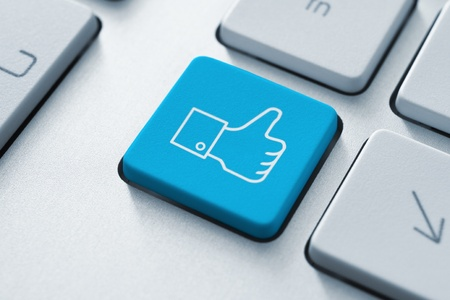 Thumb up like button on the keyboard  Toned Image Stock Photo - 12449116