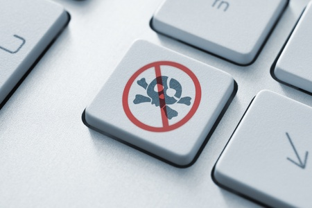 computer attack: Anti piracy button on the keyboard  Toned Image  Stock Photo