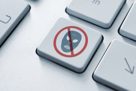 cyber crime: Anti raiders attack button on the keyboard  Toned Image