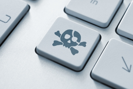 attacks: Piracy attack button on the keyboard  Toned Image  Stock Photo