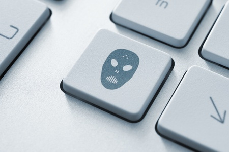 Raiders attack button on the keyboard  Toned Image Stock Photo - 12449147