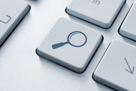 seeking solution: Search button on the keyboard  Toned Image  Stock Photo