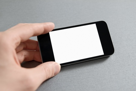 Man hand showing mobile smart phone with blank screen  photo
